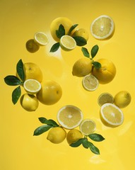 Whole and half lemons with leaves