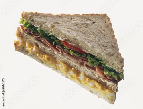 Double-decker egg, ham & lettuce sandwich in granary bread