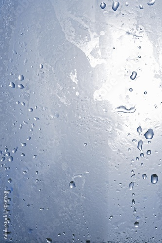 Drops of water on a sheet of glass