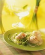 Sole rolls in white wine sauce with herbs