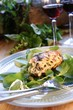 Chicken breast on herb salad