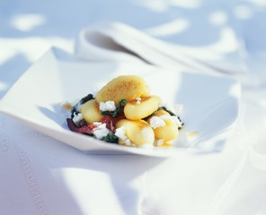 Gnocchi with olives, spinach and feta