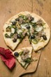 Pizza with tuna, chard and olives, a slice cut