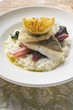 Sea bass fillets with risotto and chard
