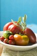 Assorted tomatoes with olive sprig on plate