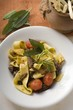 Ribbon pasta with braised oxtail, tomatoes, grissini