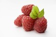 Several raspberries with leaf
