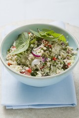 Couscous salad with vegetables and mint