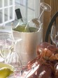 White wine bottle in ice bucket, wine glasses, lobster, lemon