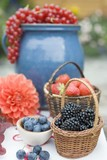 Summer berry still life on table out of doors