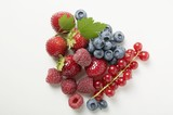 Assorted berries with leaves