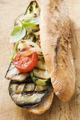 Grilled vegetables and basil in baguette