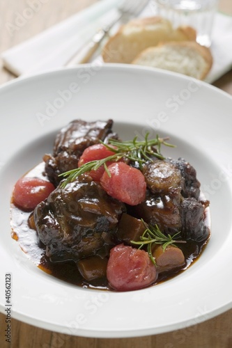 Braised oxtail with tomatoes and rosemary