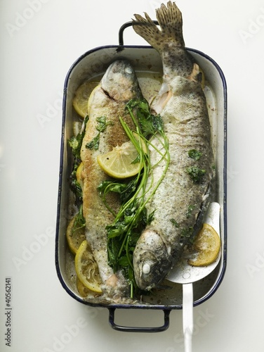 Roast trout in roasting tin