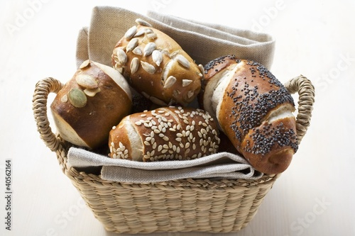 Assorted pretzel rolls (or lye rolls) in bread basket