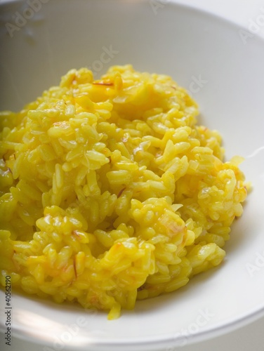 Saffron risotto on white plate