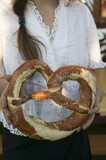 Woman holding giant pretzel at Oktoberfest