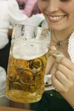 Woman drinking a litre of beer at Oktoberfest