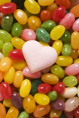 Coloured jelly beans & pale pink sugar heart (full-frame)