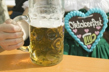 Woman with litre of beer at Oktoberfest