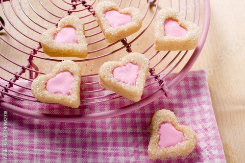 Heart-shaped biscuits for Valentine's Day on cake rack