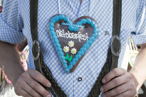 Man with Lebkuchen heart at Oktoberfest