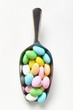 Coloured sugared almonds in small scoop