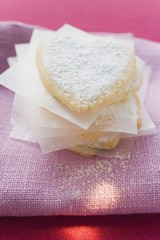 Delicate pastry hearts with icing sugar