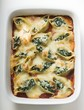 Baked pasta shells with spinach filling