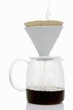 Making filter coffee (pouring hot water onto coffee)