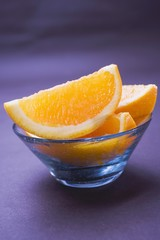 Several orange wedges in glass bowl