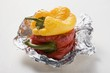 Grilled peppers on aluminium foil