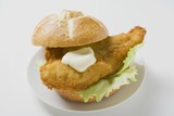 Breaded fish fillet and mayonnaise in bread roll
