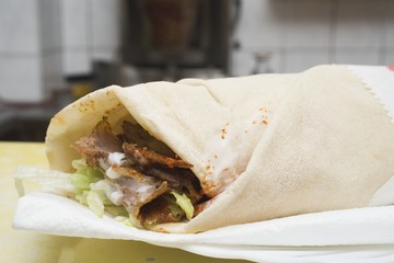 Döner wrap on paper napkin in snack bar