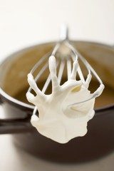 Gravy in pan, whisk with crème fraîche resting on pan