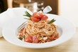 Spaghetti with tomatoes and rosemary