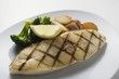 Grilled cod steak with potatoes and broccoli