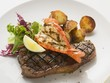 Surf and Turk (prawn and beef steak) with roast potatoes
