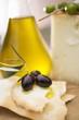 Black olives, crackers, olive oil and Parmesan