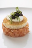 Tower of salmon tartare, white toast, sour cream & caviar