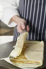 Folding a crêpe
