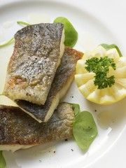 Fried trout with lemon (overhead view)