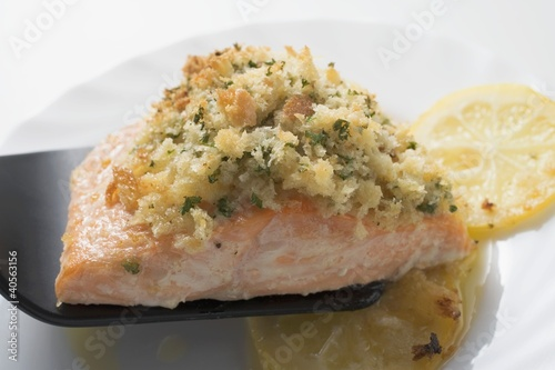 Baked salmon fillet on spatula