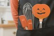 Kitchen tools for Halloween in an apron pocket