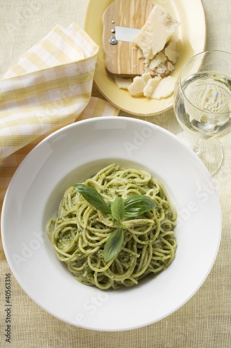 Spaghetti with pesto, Parmesan and glass of white wine