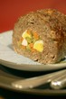Meatloaf stuffed with egg, carrots and gherkins