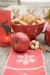 Christmas decoration: nuts, apple, cinnamon and candle