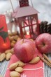 Christmas decoration with apples, nuts, cinnamon & lantern