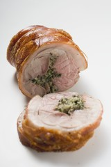 Rolled pork roast with crackling and herb stuffing
