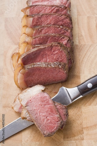 Beef steak with fatty edge, sliced